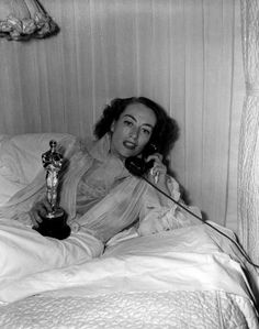Joan Crawford  (1946)  Joan wins the Oscar for Best Actress for her role in Mildred Pierce. Beset by nerves, she stays home from the ceremony; reporters later converge on her house and snap pictures of her in bed with Oscar