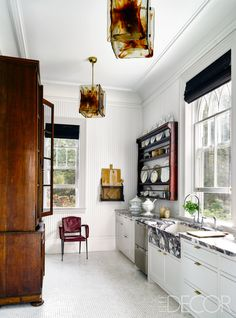 The kitchen counters and sink are custom made, and the dishwasher is by Fisher & Paykel. - ELLEDecor.com