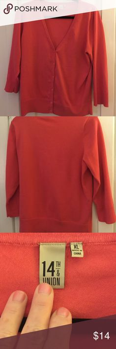 Tangerine Botton down Sweater Not bright orange, sort of a muted orange. Soft and not thick, but no thin either. Great with white button down and blue jeans with hat & Toms. Fits true to XL or L w layers. No stains or rips. Good condition. Basic and classic. 14th & Union Sweaters Cardigans
