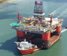 HUGE FLOATING OIL PLATFORM TRANSPORTED BY HUGE SHIP