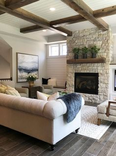 Arranging furniture facing the fireplace/TV focal point. Beautiful living room with shiplap wall and ceiling.