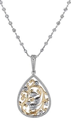 Gold and white Diamond Pendant from Michael Beaudry at DK Gems. You will find a large choice of diamond pendant and pendants at DK Gems, the Best duty free St Maarten jewelry stores located on Front street in Philipsburg.