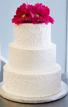 A simple, beautiful white wedding cake with pink flowers. Cake # 028.