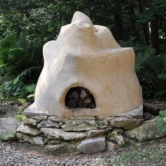 Hand-sculpted earthen oven using cob building technique.