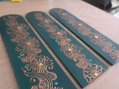 henna inspired bookmarks designed by me in green and gold with gold and turquoise gems <3