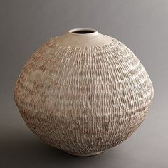 Clyde Burt, artist.  Large ceramic gray vessel with etched design