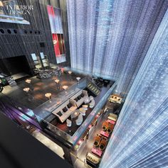 At Fei Ultralounge, part of the W Guangzhou hotel in China, fiber-optic strands pulse and change color and descending the full 60-foot height of the curtain wall.