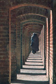 Chador-veiled women on the walkway of the bridge of Si-o Se Pol Isfahan, Iran ~ Photo by...Daniel Nadler©