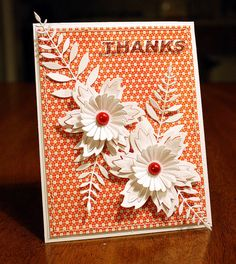 white die cut flowers + folliage on a tiny print paper...delightful card...