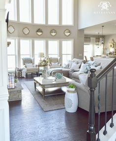 Kelley Nan: Cool Tone Spring Ready Living Room Tour- Two story neutral living room with two story windows in family room   Versatile Gray by Sherwin Williams   Dark hardwood floors in Nottaway Hickory Weathered Saddle   Gray sectional sofa