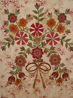 beautiful flowers- what a great medallion for the center of a quilt and then pieced blocks all around. This looks very vintage