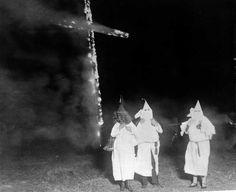 Ku Klux Klan members and a burning cross, 1921 — in Denver, CO.