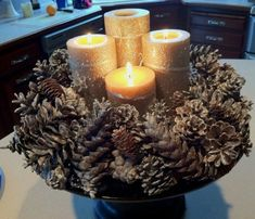Rustic, Natural, Pine cone Advent Wreath - Does not have the traditional advent candle colors, but I am ok with that :D - To signify which candle is which, perhaps add a ribbon of the appropriate traditional color to each. Advent Candle Colors, Advent Wreath Candles, Christmas Advent Wreath, Xmas Wreaths, Christmas Candles, Christmas Fun, Christmas Decorations, Advent Wreaths, Christmas Projects