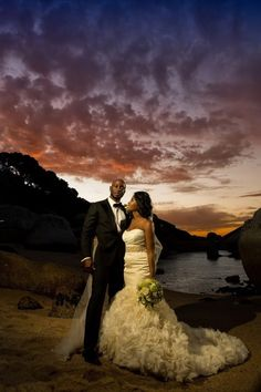Via Munaluchi Bridal - she really DID that thang! Husband is tall, dark and handsome, wedding was in South Africa, backdrop is STUNNING and she is WERKing every stitch of that dress!
