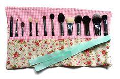 Organizador de brochas de maquillaje.