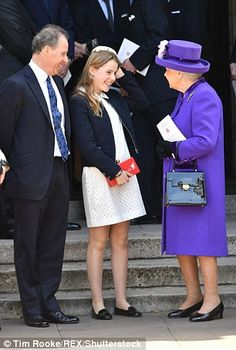 Her Majesty greets the Earl of Snowdon, far left, and his daughter Lady Margarita Armstron...