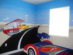 Don't know it I'd do this, but it is lots of fun.  Car bed plus mural makes kid seem like he's about to drive off into the distance!