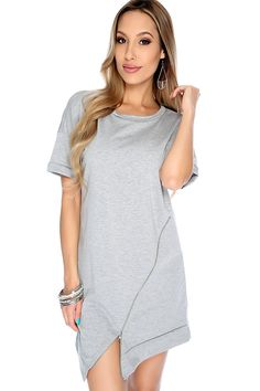 Make a bold statement in this simple casual dress it features; round neckline, short sleeves, zipper trim detail, and fitted.