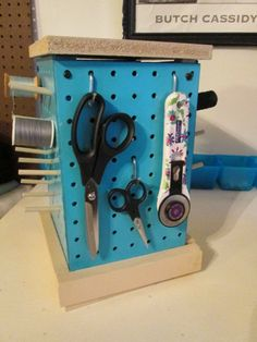 Sewing Desk & Thread Organizer- I made this pegboard organizer to sit on my desk in my sewing room. It's designed to spin to get to over 30 spools of thread and basic sewing tools. Hopefully these will be for sale soon...