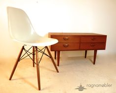 tv stand by Kai Kristiansen and the obligatory side chair by Ray & Charles Eames for H. Miller