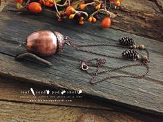 Here's a beautiful antique copper acorn with two tiny antique copper cones and four speckled jasper beads.  Available now.  Link to our store in our bio. #leafseedpodshell #leafseedpodshelljewelry #birdhouse #leaves #leaf #acorn #acorns #seeds #pods #shells #copper #electroform #electroforming #electroformed #electroplated #electroplating #nature #natural #rustic #plating #jewelry #jewellery #pendant #pendants #handmade #handmadejewelry