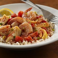 Shrimp with Artichokes and Tomatoes... Shrimp combined with Italian-herbed tomatoes and artichokes makes a tasty topper for brown rice.