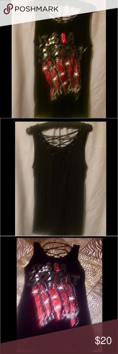 "❤NWT. SUPER COOL Medium  ""It's a Spirit"" Flag Tank This Cowgirl Tuff Co. Medium Black Tank Says It All!  This Loose Fit Unique Flag(Foil) Design Also Has Lots of Bling that spells out ""Its a SPIRIT! It also has a Lace Up Back. 95% Rayon. 5% Spandex.  NWT Cowgirl Tuff Co.  Tops Tank Tops"