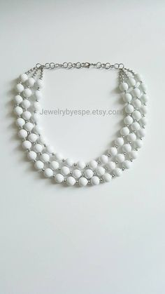 Hey, I found this really awesome Etsy listing at https://www.etsy.com/listing/264434217/white-beaded-statement-necklace-silver