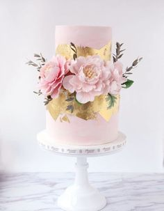 12 Peony-Inspired Wedding Ideas For The Prettiest Day Ever - Wilkie Blog! - Pretty pink peonies on a two tiered pink and gold wedding cake Cake decorating ideas #weddingideas #weddingdecor #peonieswedding #pinkpeonies #goldweddingcakes