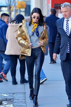 Kendall Jenner wearing RTA Denim Elson Jeans in Black Wax, Louis Vuitton Republic Ankle Boot, Krewe Ward Sunglasses, Ports 1961 Gold Jacket and Re/Done 1960s Slim Tee