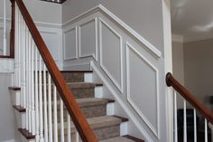 This article is a complete tutorial on how to install shadow box trim or molding squares to a wall in your home. Stair Moulding, Chair Rail Molding, Wood Molding, Crown Molding, Diy Molding, Stairway Walls, Stairway Wainscoting, Wainscoting Ideas, Stairs Trim