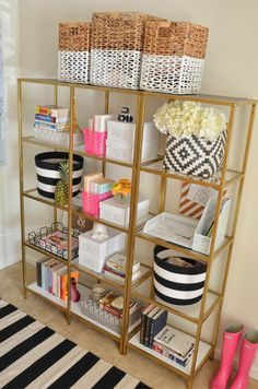 Bookcase   Ikea ( painted it from black to gold) Rug   Homegoods loving this one Baskets ( on top)   Homegoods similar Baskets ( Black/White)   Target Monogram Letters   Anthropoloige Pink Baskets   Target ($1 section) White Travel Boxes ( DIY)   Michael's similar Grey Boxes   Homegoods Flower arrangement   Target Gold Glass Tray   …