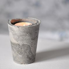 DIY concrete candle holder made with two plastic cups!