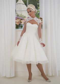 f230833ee90c Ada - Quirky and beautiful tea length wedding dress with full illusion  sleeves, sweetheart bodice and keyhole neckline. Delicate lace applique  covers the ...