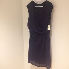 Plus size keyhole purple dress. Women's size 18W Flattering side ruching. Black trim at collar. 96% polyester 4% elastane. Machine wash cold in gentle cycle. Nine West Dresses