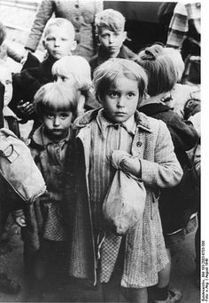 """Repatriation of German children from Poland in August 1948, one of the series of the flight and expulsion of Germans after World War II.The original caption of the photo says: """"These German kids have just arrived with a transport from the Polish territories in a small town in West Germany. Doubt and mistrust are in sight of the girl's eyes."""" Photo courtesy of Das Bundesarchiv via Wikimedia Commons."""
