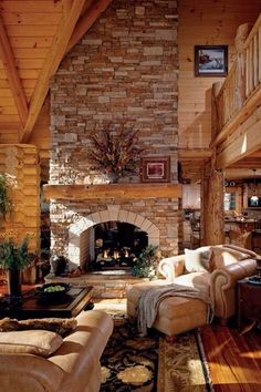 Rustic Living Room with Loft, Omnia Furniture Sedona Leather Sleeper Sofa, Columns, Hardwood floors, stone fireplace