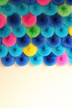 Scalloped paper fans for a party backdrop.