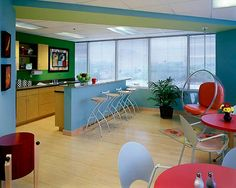Create a Stellar Office Break Room Nothing brings more energy to a room than color. For an extra measure of fun, tape off cool designs to allow for a variety of bright colors.