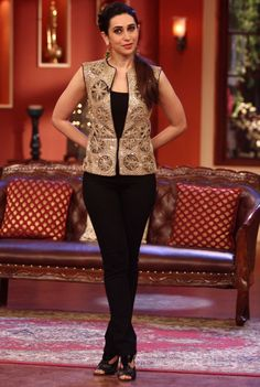 Karisma Kapoor wearing a Ritika Mirchandani vest and Mrinalini Chandra earrings.