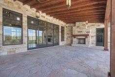 Our door living area.  Pine ceiling, fir columns, stone fireplace, flagstone floor.  Built by Olson Defendorf Custom Homes, Austin, Texas.