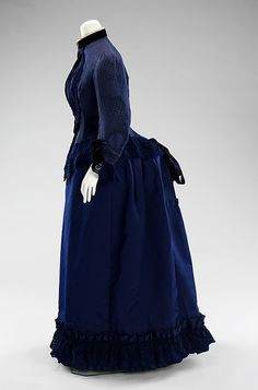 "Blue silk crepe and faille dress (side view), by Emile Pingat, French, ca. 1885. ""In this exemplary dress, Pingat presents a complex monochromatic scheme with a variety of textiles. The variations in tonality are created through textures of low luster patterned crepe contrasting with the sheen of faille alongside a sense of openness and light in the blue eyelet. All of these combined create an air of sophistication while the simple hint of cream cotton eyelet lends a sense of informality."""