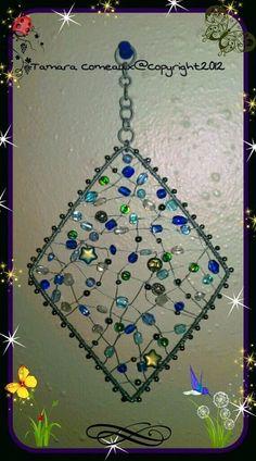 Wrapped Wire Beautiful Handmade Beaded SunCatcher glass beads: http://www.ecrafty.com/c-2-glass-beads.aspx