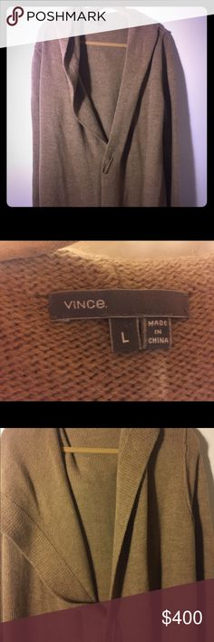 Long Vince Camel color open front hooded jacket. Vince oversized, long, camel colored, hooded open front sweater jacket . Size large but this will fit 12-18 . Oversized safety pin front closure. Beautiful camel color. Very warm. I wore this twice no visible signs of wear. Excellent condition. Vince Jackets & Coats