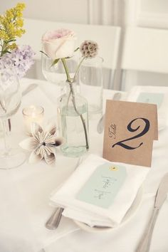 Literary Book Lover DIY Wedding Styling Ideas.  Deck the tables with sprigs of greens, floral singlets and paper blooms placed inside the vintage bottles you collected earlier. Make sure to choose flowers that fall within your colour palette, and stick to a maximum of two colours of glass.  ♥  ♥  ♥ Follow us on Facebook: www.facebook.com/confettidaydreams ♥  ♥  ♥ #bookwedding #librarywedding  #diy #wedding