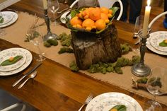 Upclose table shot with homemade burlap runner, moss, fresh citrus and salvaged tree stump