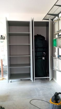 Neat and Efficient    Schulte FreedomRail Garage Storage System     Xmas Tree and Xmas Storage Cabinets