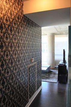 Tempaper's Damsel in Black & White creates depth in a hallway of a small condo.