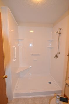 Walk in shower with corner seat. Great for sitting in the shower. Safe shower solution.