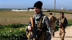 "US national ""Brett"" (L) patrols a road in the town of Al-Qosh, in northern Iraq, where he is fighting Islamic State (IS) militants alongside Christian militia group Dwekh Nawsha"